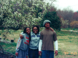 """Sydney with younger sister Rhendy and brother Jay.  Thaxton laughed, We were outside picking up sticks. One of the many """"fun"""" tasks my dad used to make us do, hence my brother's """"pleasant"""" face."""